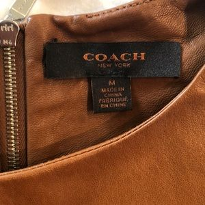 Coach Tops - NEVER WORN Coach 100% leather shirt size M.